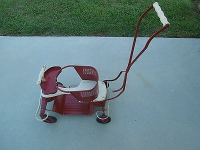 A Vintage 1940-1960's  Red Child Stroller and Walker