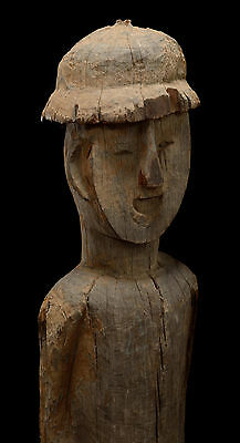 ancient Jorai funerary male statue with topee from Vietnam