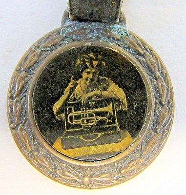 c.1900 H. N. White KING BOOSTER CORNET Cleveland OH celluloid watch fob w/ strap