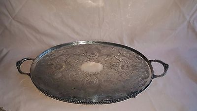 A large vintage silver plated tray on clawed legs by vintage of sheffield