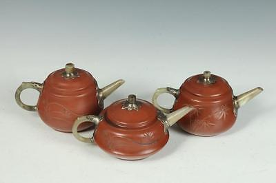 THREE CHINESE YIXING TEA POTS, Maker's mark. - Largest: 6 3/4 in. long. Lot 139