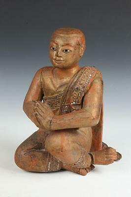 BURMESE GILT WOOD FIGURE OF PRAYING MONK. - H: 15 in. Lot 11