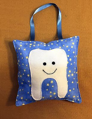 small blue hanging tooth fairy pillow