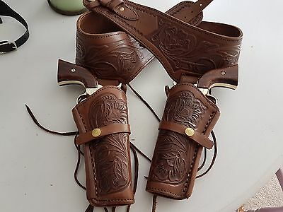 Cowboy double holster, brown leather hand tooled made in Mexico.