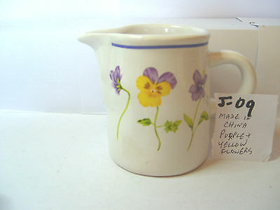 jug with purple and yellow floral
