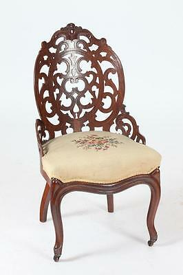 LATE 19TH CENTURY AMERICAN ROSEWOOD BARREL BACK CHAIR WITH NEEDLEPOIN... Lot 379