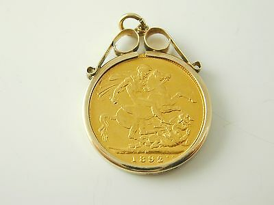 Full sovereign Victoria dated 1892 pendant charm 9 carat gold mount 9.4 grams