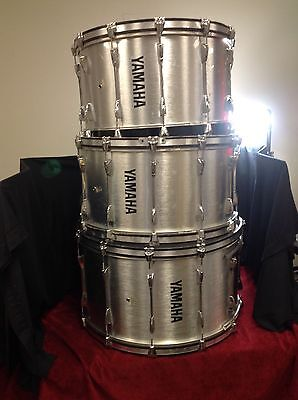 Silver Yamaha Field Corps Bass Drum 30', 28', and 26' W Cases