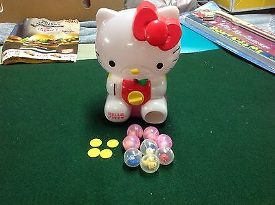 Hello Kitty Blip bubble machine with tokens and toys