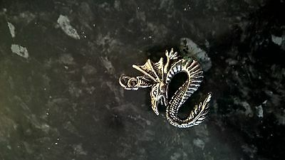 Dragon moulded silver colour pendant - Chinese year of the dragon
