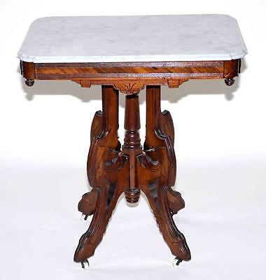 AMERICAN EASTLAKE WALNUT MARBLETOP TABLE WITH ORIGINAL MARBLE AND CAS... Lot 373