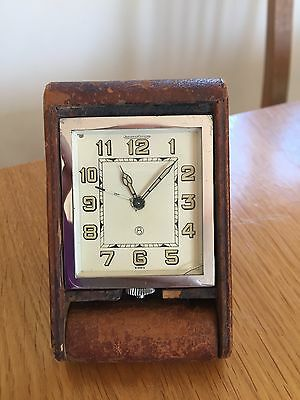 A beautiful vintage Jaeger Lecoultre leather case travel alarm clock, working