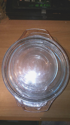 Set of 3 PYREX Clear Glass Casserole Dishes with Lids.