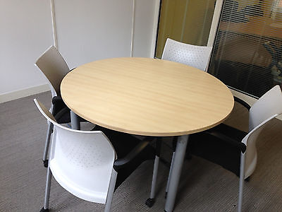 Round office meeting table Senator  with  4 design black & white chairs on wheel