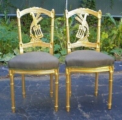 Gorgeously carved Louis XVI style gilded chairs