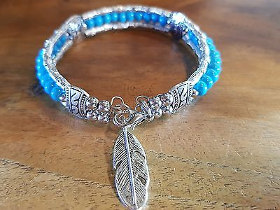 American Indian style turquoise style bracelet with feather
