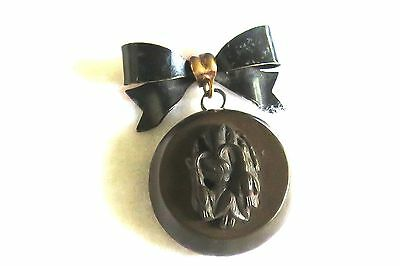 Vulcanite Locket With Photo On Black Metal Bow