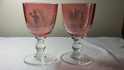 A pair of large Bohemian Mary Gregory style pink glass goblets
