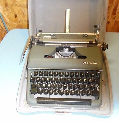 Vintage Olympia Deluxe Midcentury Manual TYPEWRITER in Steampunk Silver Case