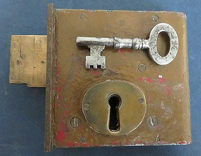 Vintage old antique Gibbons Cell Gate Lock with key. Prison or Police Station.