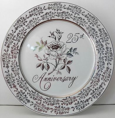 A GIFT OF LOVE 25th SILVER ANNIVERSARY FINE PORCELAIN MUSICAL FOOTED CAKE PLATE