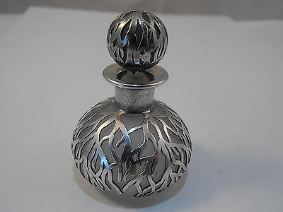 small scent bottle with silver overlay