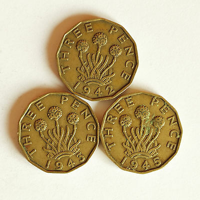 Three George VI brass THREE-PENCE coins dated 1942, 1943 & 1945