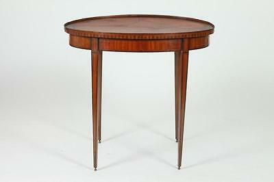 LATE FEDERAL OVAL MAHOGANY TEA TABLE IN THE HEPPLEWHITE STYLE. Early... Lot 398A