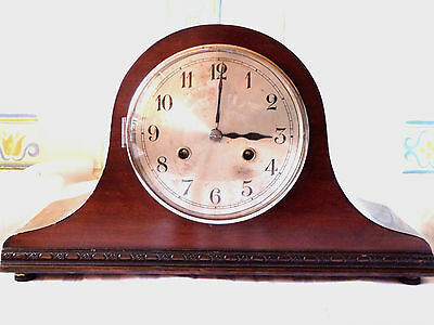 Vintage mantel clock striking  Napolean hat shape.Mahogany case.
