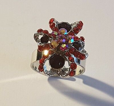 Sparkling silver tone red stone bow ring. Metal detecting beach find