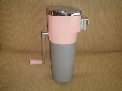 vintage pink ice crusher/ great condition with bracket
