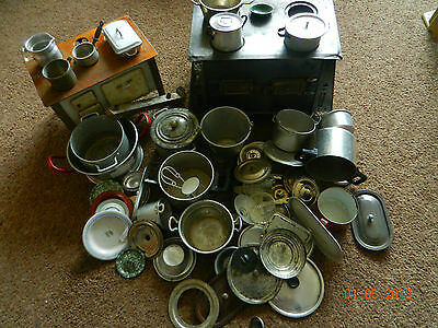 large collection of dolls house kitchen utensils and ovens