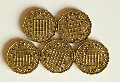Five Elizabeth II brass THREE-PENCE coins dated 1958 to 1962