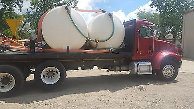 1997 Peterbuilt 330 Flatbed with 2,000 Gallon HDD Mud Mixing System
