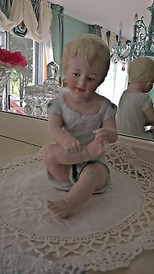 Charming Vintage Bisque Porcelain Hand Painted Large Piano Baby Figurine