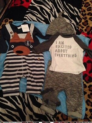Cute little outfits from next. one used and one new with the tags