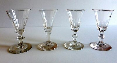 Four charming Victorian and/or late Georgian wine glasses, all slightly damaged.