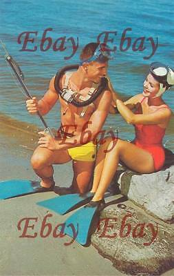 Postcard, Man & Women in the vintage diving gear, diver, nude, ca. 1960, Repro
