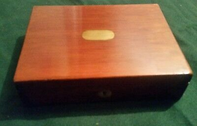 Beautiful Old Wooden Box With Compass set and military background.