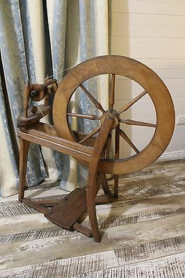 Wooden vintage spinning wheel. Original condition