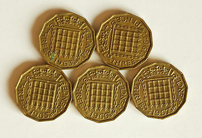 Five Elizabeth II brass THREE-PENCE coins dated 1963 to 1967