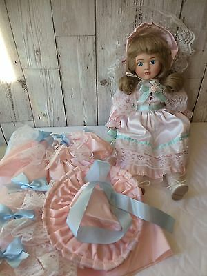 "Porcelain Doll 16"" With A Extra Dolls Clothing"