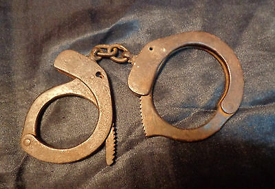 Old USSR/Russian military police iron handcuffs.