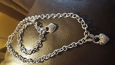 Stunning Sterling silver heart and diamond pendant necklace and bracelet set.