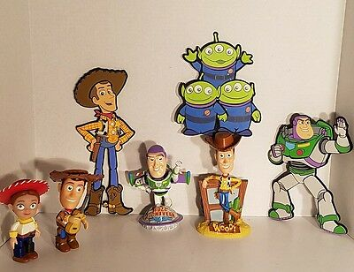 Collection Of Disney Collectibles,Woody, Buzz Lightyear, Jesse Bobbleheads, Wall