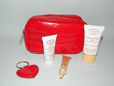 Clarins Gift Set - Sample Sizes In Clarins Small Red Zipped Cosmetic Bag