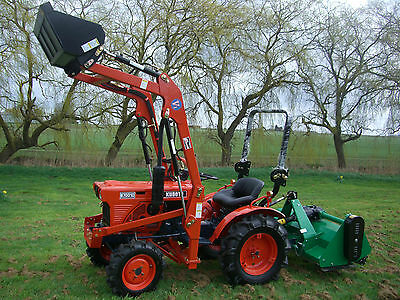 Kubota compact mini tractor with loader and new flail mower.