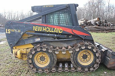 Skid Steer New Holland LS 185b with Skid Steer Forks Skid Loader