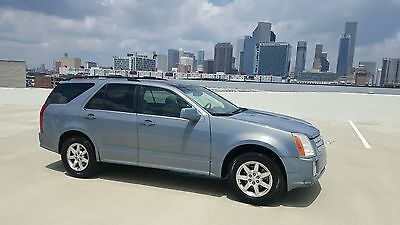 2007 Cadillac SRX  2007 Cadillac SRX SUV - Panoramic Roof Woodgrain Leather Shipping No Reserve
