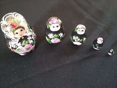 A Collection Of Five Russian Nesting Dolls